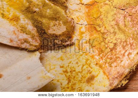 Rotten bread on table. Moldy food waste with fungus growth. Health microogranism biology concept.