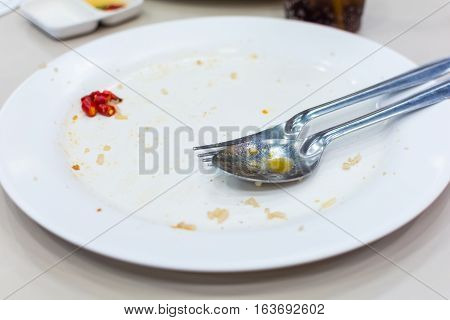 white dish with fork and spoon after eating