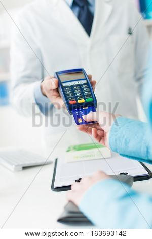 Woman Purchasing Medical Products