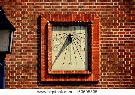 Alexandria Virginia - April 13 2014: Sundial clock on a brick wall at historic Christ Church * time