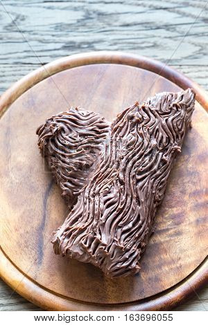 Yule log on the wooden board: top view