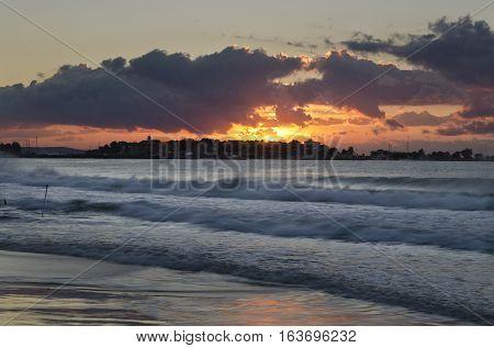 Sunrise on the beach in the resort Nesebar in Bulgaria