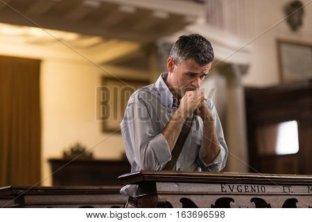 Man Praying In The Church
