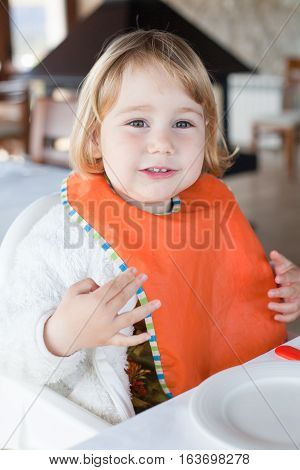 Cute Baby Orange Bib Eating