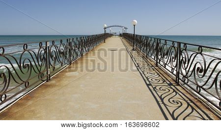 Landscape with beautiful pier on the sea recorded in Saints Constantine and Helena resort Bulgaria.