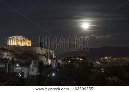 Full moon over the parthenon of the acropolis at night Athens Greece