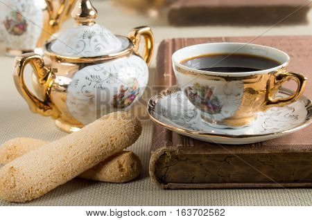 Morning Espresso And Cookies Savoiardi On A Table