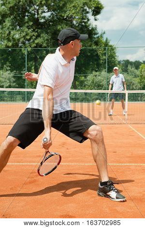 Hot dog tennis trick shot usually performed after a lob while running back
