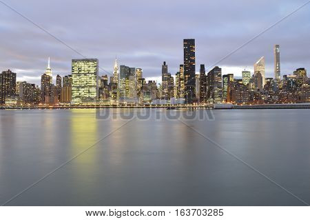 A night view of the Manhattan skyline with copy space.
