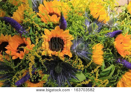 Blue and yellow wedding flowers: sunflowers and eryngium or sea holly