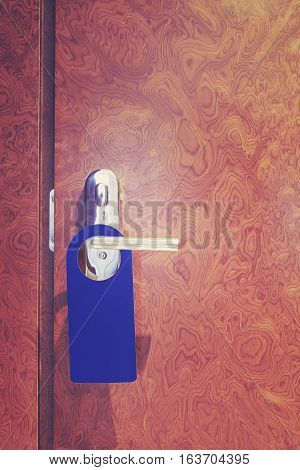 Vintage Toned Hotel Room Closed Door With Hanger.