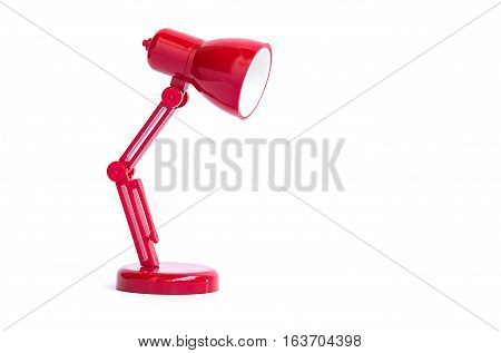 Small Red lamp put on white background