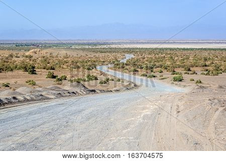 Dirt road on Maranjab Desert in Iran