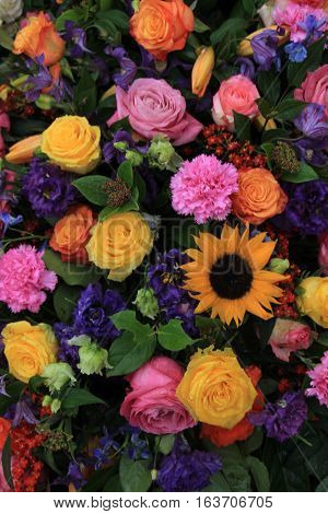 Mixed colorful flowers in a floral wedding decoration