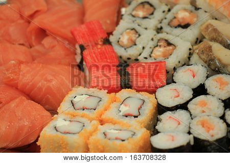 Japanese sushi and sashimi various sorts on a serving plate
