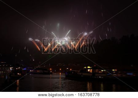 Big Fireworks Upon River With Boats