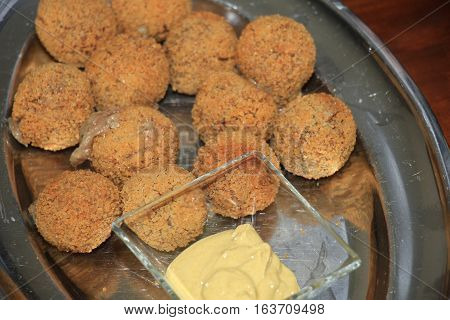 Bitterballen with mustard warm fried snack served in the Netherlands