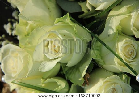 Big ivory white roses in a floral wedding arrangement