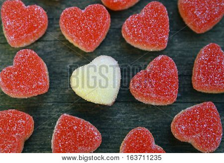Heart candies coated with sugar as a background. Sweet red and white candy hearts. Valentines hearts candies.