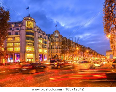 ParisFrance - 27 November 2016: Night image of the famous Champs Elysees Boulevard in Paris festive decorated during the winter holidays.