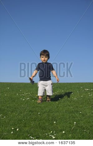 Child Standing In Field