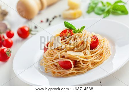 Pasta with tomato sauce parmesan cheese and basil Italian food