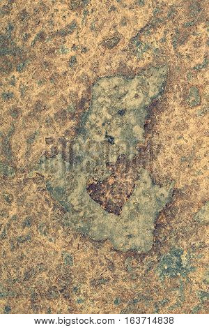 Naturally yellowish patterned slate surface for background toned (Digitally Altered: Toned Image)