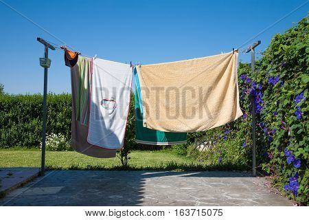 Several Towels Lying On Exterior Clothesline