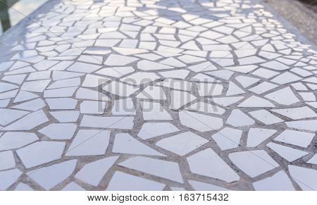 Pattern of broken white tiles, brittle, mosaic, trencadis breakable, enamelled ceramics glazed