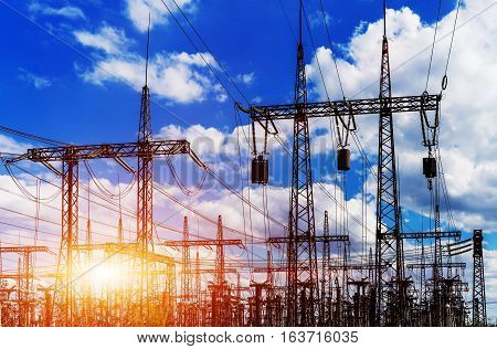 Sun setting over an electrical substation closeup