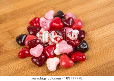 Valentine Colored Heard Shaped Jelly Beans Isolated On A Wood Background