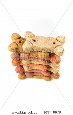 Stack Of Multicolored Dog Biscuits Isolated On A White Background