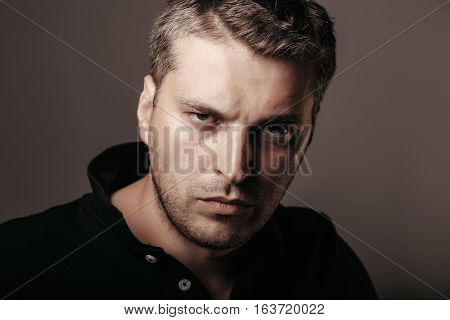 handsome sexy man or guy with stylish hair on serious unshaven face in shirt on grey background closeup