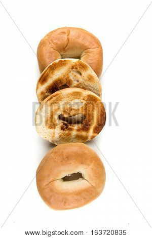 Plain White Toasted Bagels Isolated On A White Background