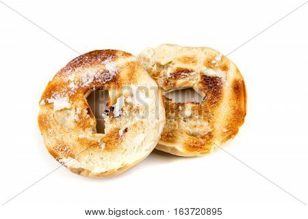 Plain White Toasted Buttered Bagels Isolated On A White Background