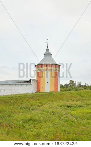 Fortress tower of of Saviour Priluki Monastery by cloud day near Vologda Russia.