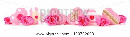 Long Border Of Rustic Pink Valentines Heart Shaped Gift Boxes And Roses Isolated On A White Backgrou