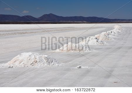 Hills of salt - salt extraction area at the world's biggest salt plain Salar de Uyuni Bolivia