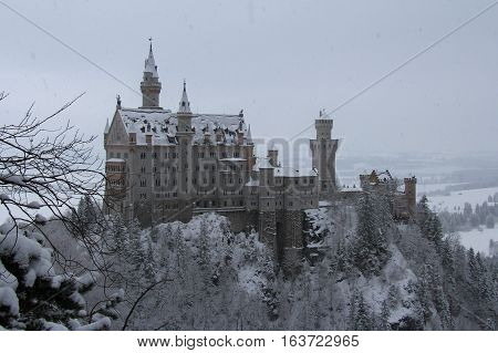Fussen Germany - December 26 2014: view of the Neuschwanstein Castle in winter time on December 26 2014 near Fussen Germany.