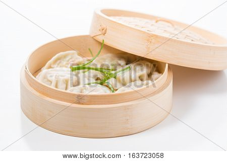 Vegetable chinese dumplings in a bamboo steamer.