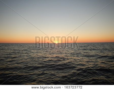 Morning sunrise viewed on the ocean horizon.
