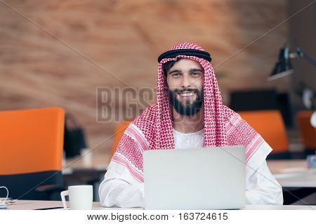 Arabian businessman working in modern startup office.