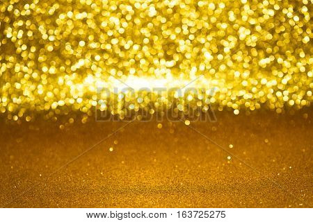 Defocused Abstract Golden Glitter With Bokeh Background