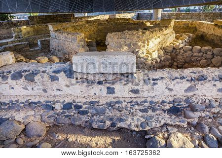 CAPERNAUM, ISRAEL - NOVEMBER 21, 2016 Saint Peter's House Ruins Byzantine Church over Humble House from early 1st Century after Jesus' death Next to Sea of Galilee Capernaum Israel Octagon base of Byzantine Church is symbol of place where Jesus walked. Ma