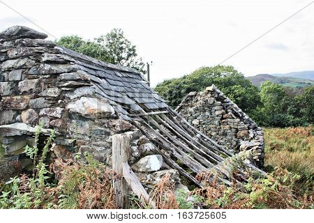 Derelict stone building with a broken roof