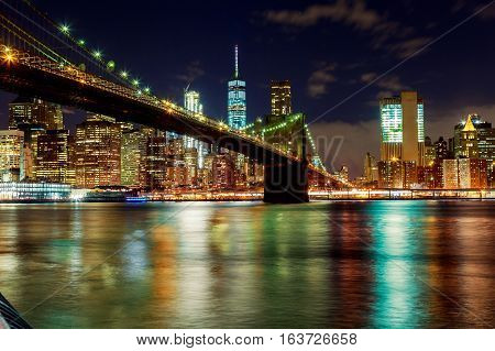 Brooklyn bridge and New York city skyline at night taken from bridge