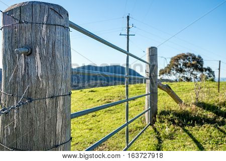 Livestock fence post and paddock commonly seen in the rural countryside.