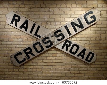 Rail Road Crossing Sign Yellow Brick Background
