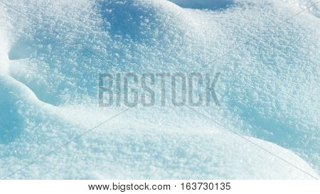 White blue glitter from fresh snow texture background