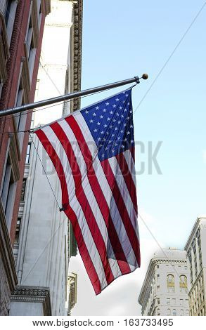 American flag hanging on a building in New York City